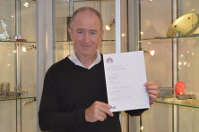 MD Christopher Dean holding BSI Certificate of Membership