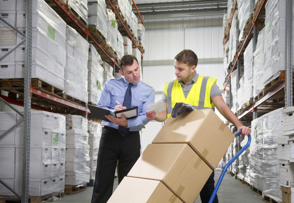 Manager and Worker Moving Warehouse Boxes iStock_000015149219_Medium