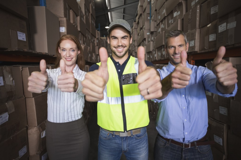 Warehouse Team Smiling at Camera iStock_000047260930_Medium