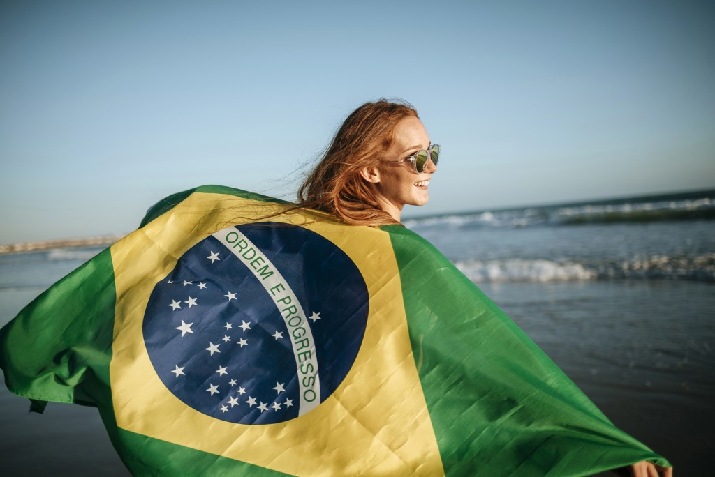 girl in sunglasses with Brazilian flag