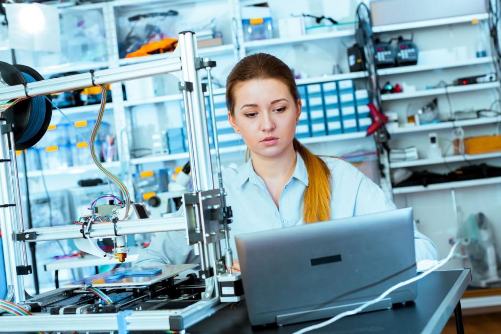 Female Architect Using 3D Printer