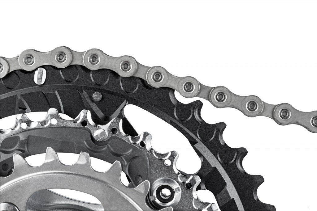 close-up of bicycle crank set with chain isolated on white background