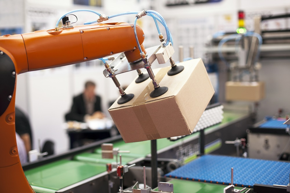 Packaging line with robotic arm at work
