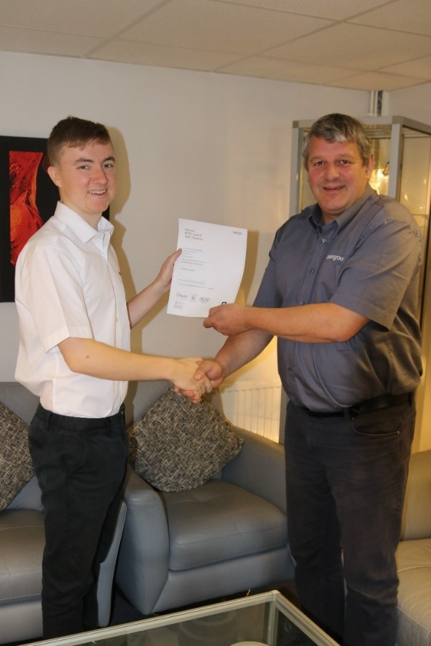 Dean Group apprentice receiving certification