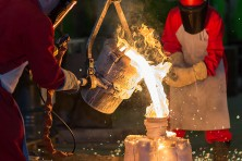 Pouring molten metal into a mould