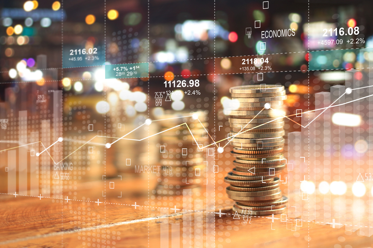 businesss charts of graph and rows of coins for finance at night city background
