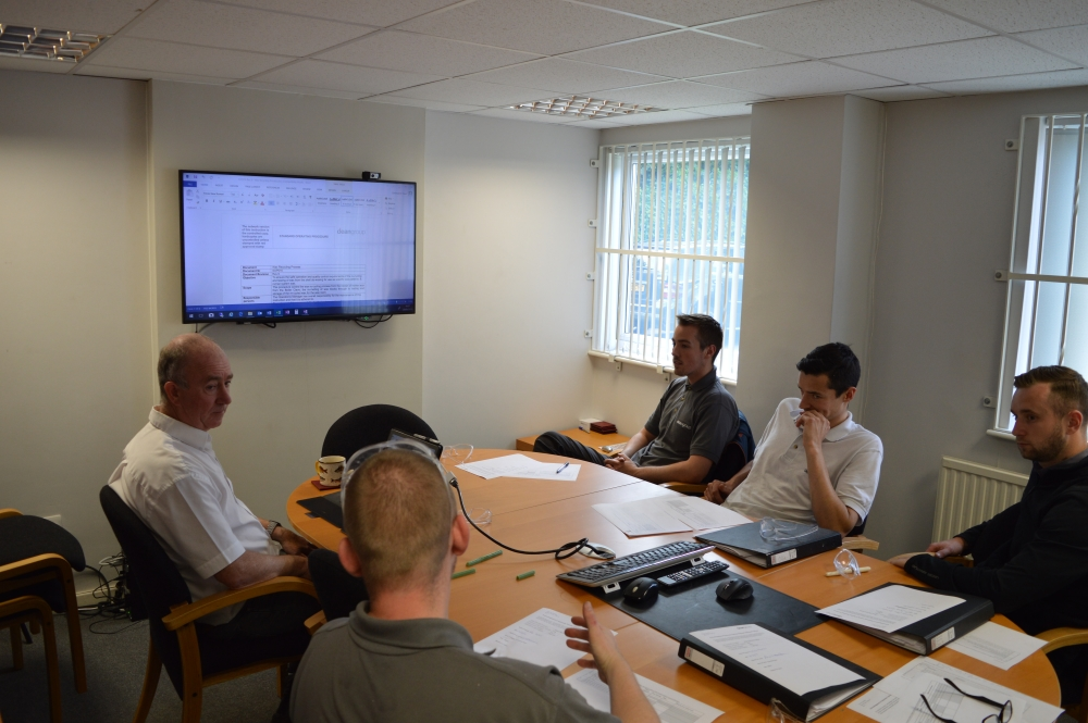 chairman christopher dean giving a training session at dean group
