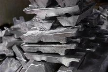 messy stack of aluminium ingots - close-up with selective focus