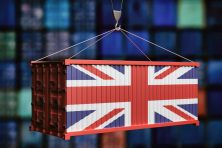 UK flag container on stacked containers background. 3d illustration